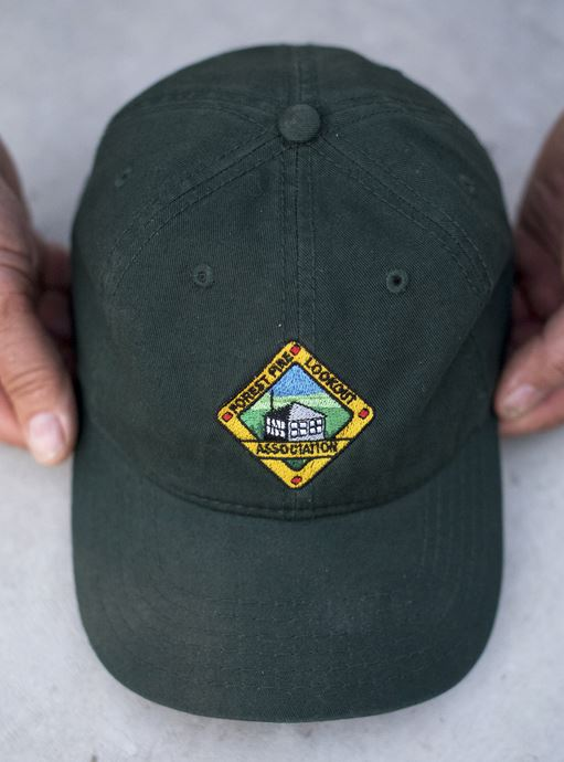 Jeff grabbed this hat he received as a volunteer for the Forest Fire Lookout Association.