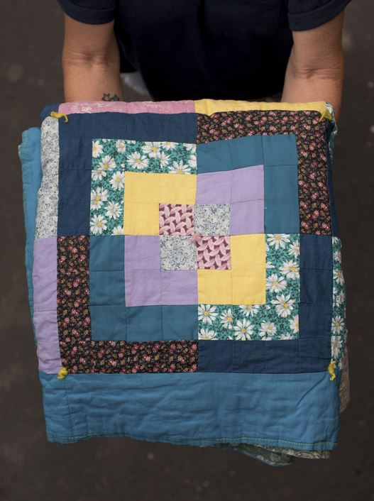 Karen was able to grab this quilt, which still keeps her warm.